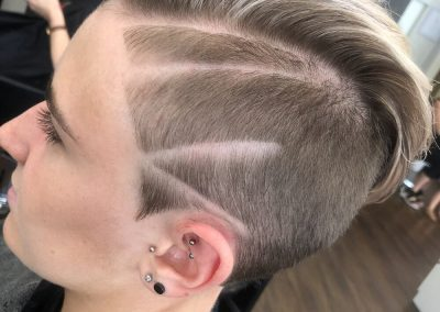 Short clippered Ladies Haircut with pattern lines